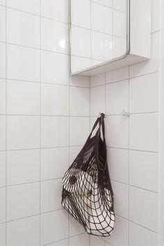 bathroom detail toilet roll storage in a black mesh net | Fantastic Frank