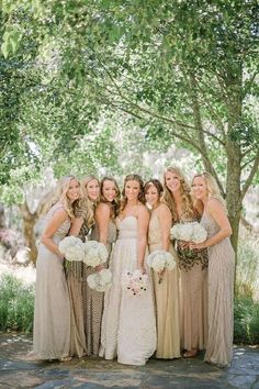 Mismatched bridesmaids dresses full of texture in shades of taupe.