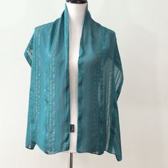 """NEW ITEM Teal & Gold Silk Sheer Scarf Cejon brand teal & gold 100% silk sheer scarf. About 61"""" long & 14"""" wide. In good condition. I'm open to reasonable offers on all my items. Thanks for browsing! Cejon Accessories Scarves & Wraps"""