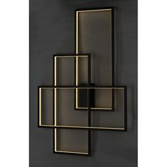 Orren Ellis Edelen LED Flush Mount Orren Ellis Intersecting rectangles finished in black throw indirect LED light off the wall for a combination of accent room illumination and modern art design.