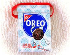 A super cool vintage oreo cookie high quality lunch bag/cooler bag! Great vintage condition. Does have the name cody written on the interior. Displays wonderfully! Only made available to employees!  Please see all pictures up close for a thorough representation! :) I have TONS more cute vintage items for sale like this in my Etsy shop - check it out for super cheap shipping discounts! (Nearly free!)  I ship WORLDWIDE from a clean, pet & smoke-free home! Please note that shipping times will…