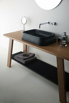 minimalist tapware.  black bathrooms by the style files like the idea of using a table as a vanity