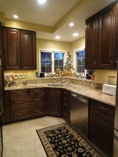 StarMark Cherry Cabinets With Harvest Stain And Chocolate Glaze, Cambria  Bradshaw Countertops, KitchenAid Steam Oven And Dishwasher.