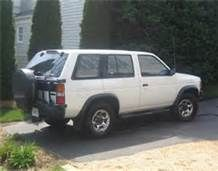 1994 nissan pathfinder - One of my favorite cars I owned. white, roof face, tire on back, tinted windows. The best.