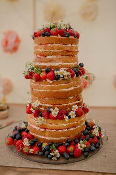 Naked wedding cake with strawberries, blueberries and camomile flowers, my mum made this : ) #nakedcake #weddingcake