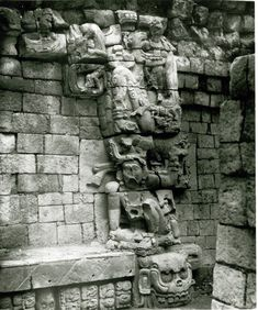 Photographs (black and white); Great Plaza; view of the Eastern Court. East side of doorway leading to the inner chambers of temple; human figure seated on a large skull. Copán, Honduras. Photographed...
