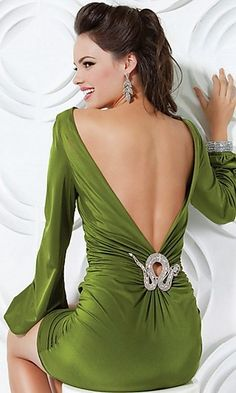 Chic, classy, feminine, elegant, rich green satin dress fits perfectly complimenting the feminine shapes. The sleeves flowing into ruffles, beautiful V-back cut and delicate detail make it look magnif