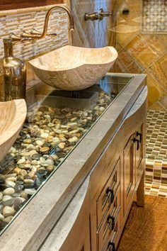 Gorgeous pebble counter tops with stone sink