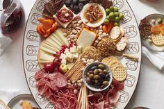 Grab the shopping list for the most epic appetizer board of all times! It's a spread to end all spreads and there's a little something for everyone.