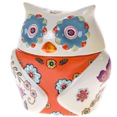 Reach for your favorite cookies tucked away in this delightful owl shaped ceramic cookie jar.