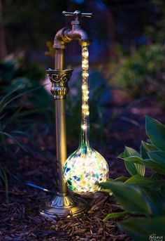 DIY Waterdrop Solar Lights - repurpose glass globe water spikes. http://www.thenavagepatch.com/diy-waterdrop-solar-lights/