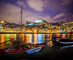 https://flic.kr/p/TZDQAL | Oporto, Portugal at night | We decided to take the tour bus up to Porto, Portugal for the day and evening. What a beautiful and amazing city! I could seriously spend a whole week here! I took about 500 photos and had some great port with new friends down here by the river. And yes, I'm living in a bus down by the river. Next stop - Madrid - then coming in for the Barcelona photo walk!