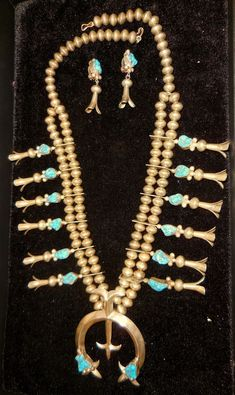 """The classic squash blossom necklace features a crescent shaped pendant, called """"Naja"""" (Nah-Hah), the Navajo word for """"crescent."""". A symbol that was common to many of the earliest civilizations. In the late 1500s and early 1600s, the saddles and bridles of huge muscled horses of the Spanish Conquistadors where fitted with sterling silver crescent-shaped pendants of Moorish origin.   eBay!"""