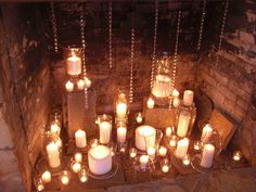 Beautiful!  Candles inside a fireplace.  I love the addition of the crystals hanging down!
