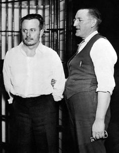 St. Paul -- Arthur Barker, the gangster whose brother and mother, Fred and Kate Barker, were slain in a machine gun battle with Federal agents in Florida while he was in Federal custody in Chicago, is pictured with chief jailer William Gates of Ramsey County, Minn., jail at St. Paul. He was taken here from Chicago, where he will face trial for the alleged kidnapping of Edward J. Bremer. (1935)