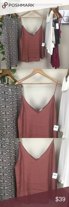 Free People tank! Intimately Free People loose-fitting tank. Be loose and carefree in this free flowing tank. Beautiful maroon/copper color. 74% nylon 26% polyester.  Size large  Offers welcome | no trades✨ Free People Tops Tank Tops