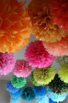 neat paper pom poms - great for decorating a party