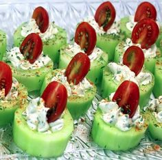 Cucumber Bites with Herb Cream Cheese and Cherry Tomatoes  4 oz Cream Cheese, Softened  1/4 Cup Ranch Dressing 2 TBS Dill  3-4 Cucumbers. skinned/sliced into 1 in. slices Cherry Tomatoes, sliced in half Sprinkle of Salt Sprinkle of Paprika for Garnish  1) Mix softened Cream Cheese with the Ranch and herbs until combined.  2) Remove Cucumber peel, Slice into 1 inch pieces. Remove center of cucumber 3) Spoon Herb Cream Cheese into center  4) Add half Cherry Tomatoes 5) Chill in fridge