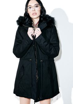 Pitch Black Parka is ready to camp out all nite, bb. This super warm parka jacket features a mid-length, thick construction that's fully lined, oversized hood with faux fur trim, drawstring waist, flap pockets, fishtail back, and zip front closure.