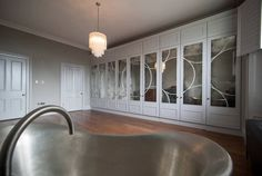 Art Deco inspired white wardrobe with stainless steel bath