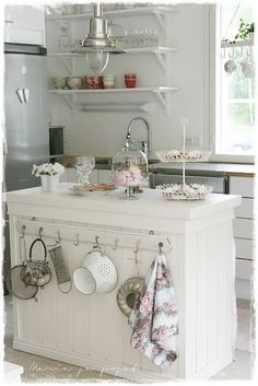 Shabby Chic Kitchen Island with Slightly Mismatched Hooks on One Side. #shabbychickitchenisland