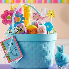 Get little ones egg-cited with a pretty, personalized Easter basket filled with wind-up chicks, candy eggs, peeps kabobs, flower lollipops and super-easy easy DIY paper flowers!