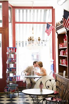 I grew up with a big coffee table book of Normal Rockwell paintings. When I found this ice cream shop in Galena, Illinois I was delighted that they allowed me to reposition several things to build this wedding portrait.  #StudioBradford www.bradfordjones.com