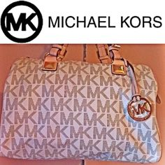 Auth MICHAEL KORS Large Satchel MK Handbag! Here I have is a gently carried  Auth MK satchel for a short time.,will come with its dust bag, will come free of any stains, rips or fades to the exterior and please look at the interior as there are 2 pint size marks, not noticeable unless you get really close, other than that this purse got me tons of compliments when I carried it...Will only consider REASONABLE offers, others will be declined❌NO TRADES❌Thank You Michael Kors Bags Satchels