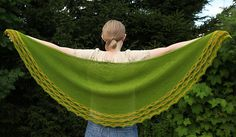 Raili's Shawl is a half-circular shawl knitted from the bottom up. The shawl uses a horizontal drop stitch pattern at the hem.