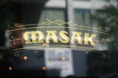 Project13.com brand/logo development. Masak Restaurant, New York. Gold leaf hand-painted sign by OKmitch.com. MasakNYC.com