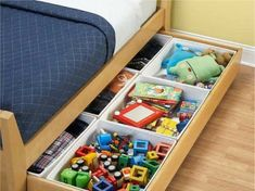 Turn a trundle bed into a storage space for toys by using small plastic separators.  Great way to use every inch of available space in a small apartment.