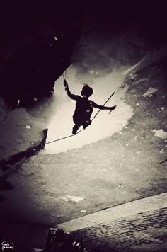 London tightrope walker reflection in a puddle via Flavorwire