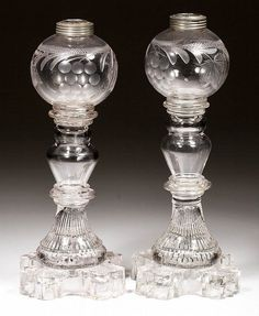 FREE-BLOWN, ENGRAVED, AND PRESSED PAIR OF WHALE OIL LAMPS Lot 520