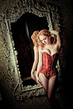 My first Sparklewren corset body, in ruby metallic silk with cording, gussets, etc., based on an 1882 patent.
