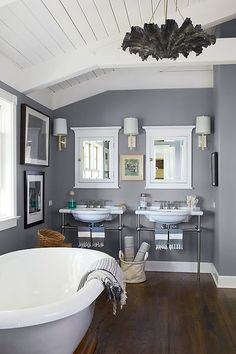 Gray's air of elegance can elevate more-casual decor choices, such as industrial-style fixtures and fouta towels, in the master bath. It also tends to be a bit easier on the eye than adding more stark white to the space.
