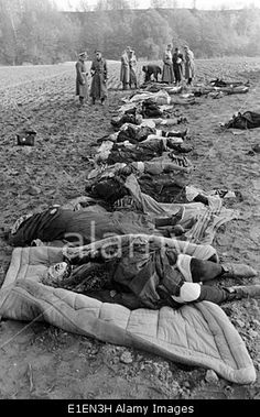 The Nazi Propaganda image shows murdered civilians after the Nemmersdorf massacre in Nemmersdorf (today Mayakovskoye, Russia) in October 1944. The Nemmersdorf massacre took place on 21 October 1944 in the then German village Nemmersdorf. According to current findings up to 30 people were killed as the Red Army advanced into the town. Even today the circumstances are still unclear. A translation of the German original Nazi news report on the back of the image reads: Soviet crimes in ...