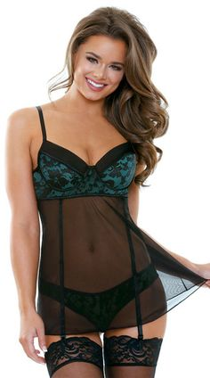 This cute black babydoll set features molded underwire cups with a green lace overlay, a black trim, adjustable spaghetti straps, a satin bow accent, a sheer back band with a hook and eye closure, a sheer mesh skirt with piping details, adjustable garter straps, a back keyhole opening, and a matching panty. (Thigh high stockings not included.) Halle Green and Black Gartered Babydoll Set, Mesh and Lace Babydoll Set, Black and Green Babydoll Set