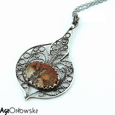 pendant: silver, silver filigree, rutile quartz