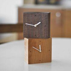 clocks (walnut or maple, 10,5 x 10,5 x 5,4 cms)