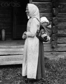"Photo of a Swedish mother carrying her small child on her back -- From Swedish blog ""Nordic Thoughts"""