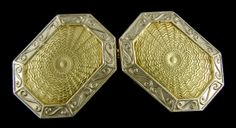 Beautifully engraved centers with radiating waves surrounded by bold borders of twisting scrolls.  This striking pair of cufflinks perfectly captures the jazzy elegance of the Art Deco era.  Crafted in 14kt yellow and white gold,  circa 1925.