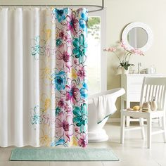 The Intelligent Design Olivia Shower Curtain uses bright colors and an…