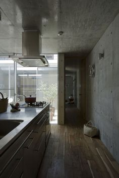 Absolutely LOVE this concrete home, designed for a craftsman, by a Japanese architectural firm.