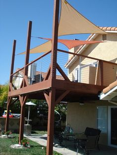 Redwood Deck with shade sails, steel wire railing.  Think the shades would work?