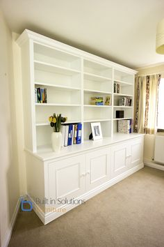 Built in Cabinets and Bookshelves, with 3 column bookcase and double Cabinets below with a pair of doors each. Created in a ornate style with large ornate cornice and beaded doors with detailed base skirting. Spray painted in white lacquer and fitted - ready to use with in a single day. Check out some of our latest work here: http://www.builtinsolutions.co.uk