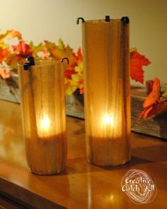 From plain glass to a customised home decor theme.  Make your own DIY candle holders using a glass vase, paper, Modge Podge glue and a little imagination.