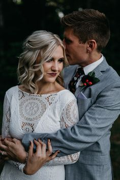 Totally in love with the dream-catcher inspired lace details on this bride's wedding dress | Image by Kelley Deal Photography