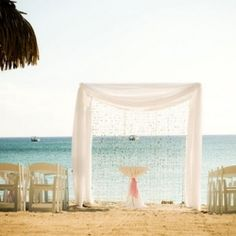 A pretty pink and grey wedding on the white sand beach of Grand Cayman.