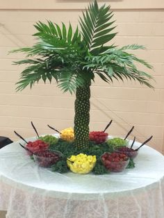 Pineapple palm tree fruit display I watched a video on how to make the . Pineapple palm t Palm Tree Fruit, Pineapple Palm Tree, Palm Trees, Hawaiian Birthday, Luau Birthday, Moana Birthday Party Ideas, Birthday Parties, Birthday Board, Themed Parties