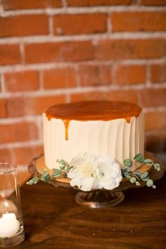 Single tiered cake covered in caramel